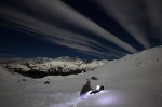 Switzerland's photographer Denis Balibouse files his pictures under a full moon sky from Mont-Cenis Pass Road in Lanslebourg during the Grande Odyssee sled dogs race
